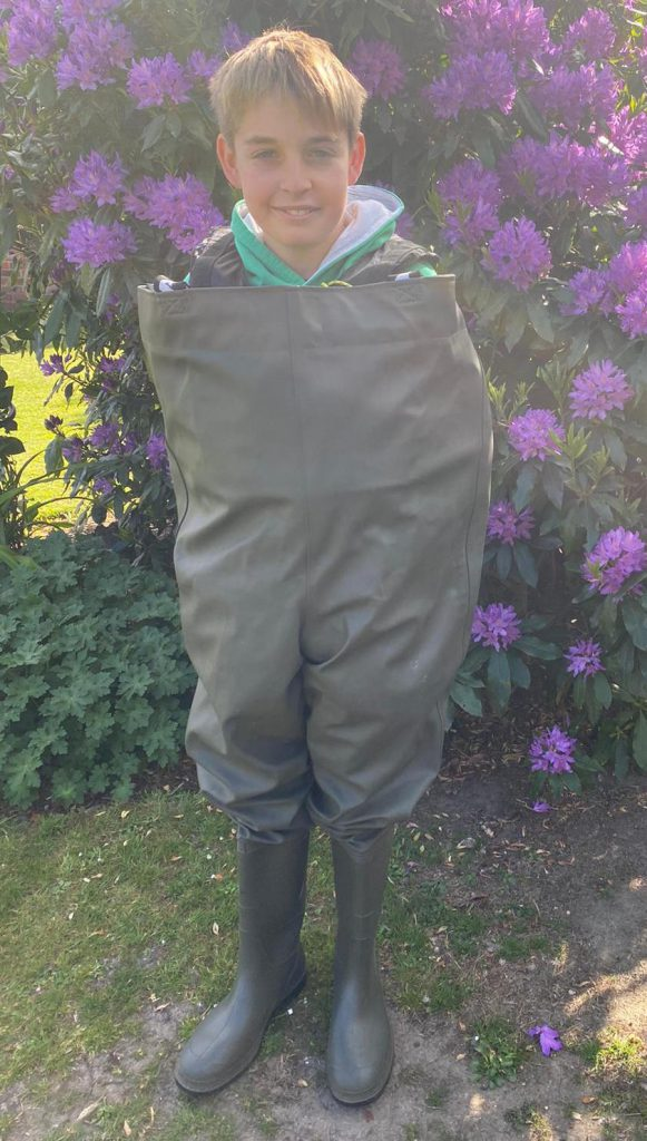 Commodore Sammy in very large waders up to his neck